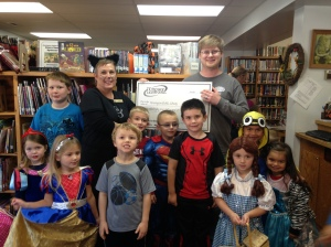Bennington Runza Manager, Zac Johns presented a generous check from the Great Books For Great Kids Fundraiser held in August for the purchase of additional children's books for the Library.